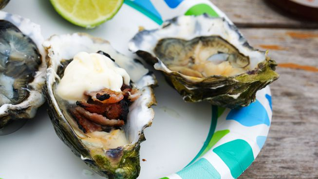 Oysters topped with bacon and cream fraiche