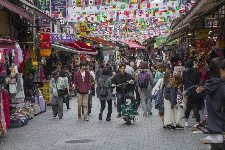 People walking through Namdaemun Market in Seoul