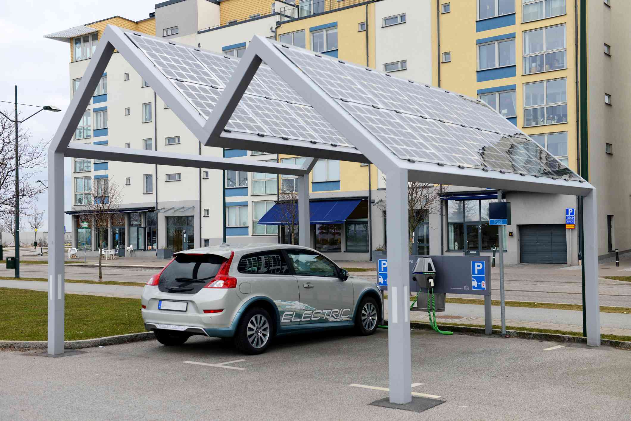 Electric vehicle charged with solar energy at an EV charging station.