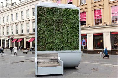 City tree bench installed on a sidewalk in Glasgow
