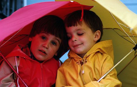 Kids with umbrella photo