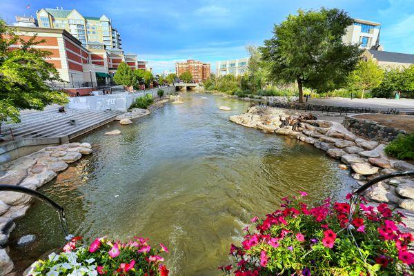 Narrow waterway running through a city landscape