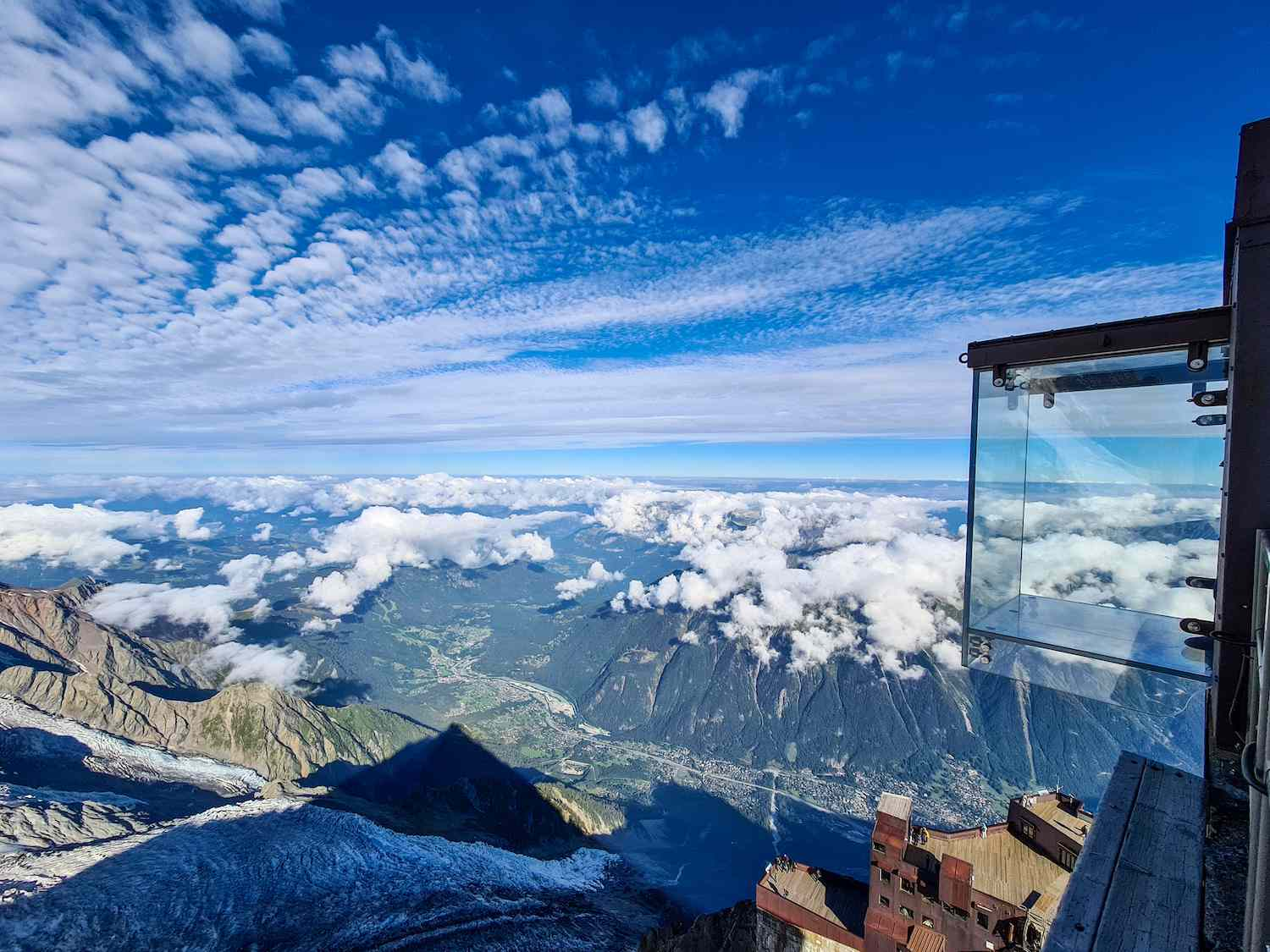 A glass room called Step Into the Void hangs over a ledge in the French Alps