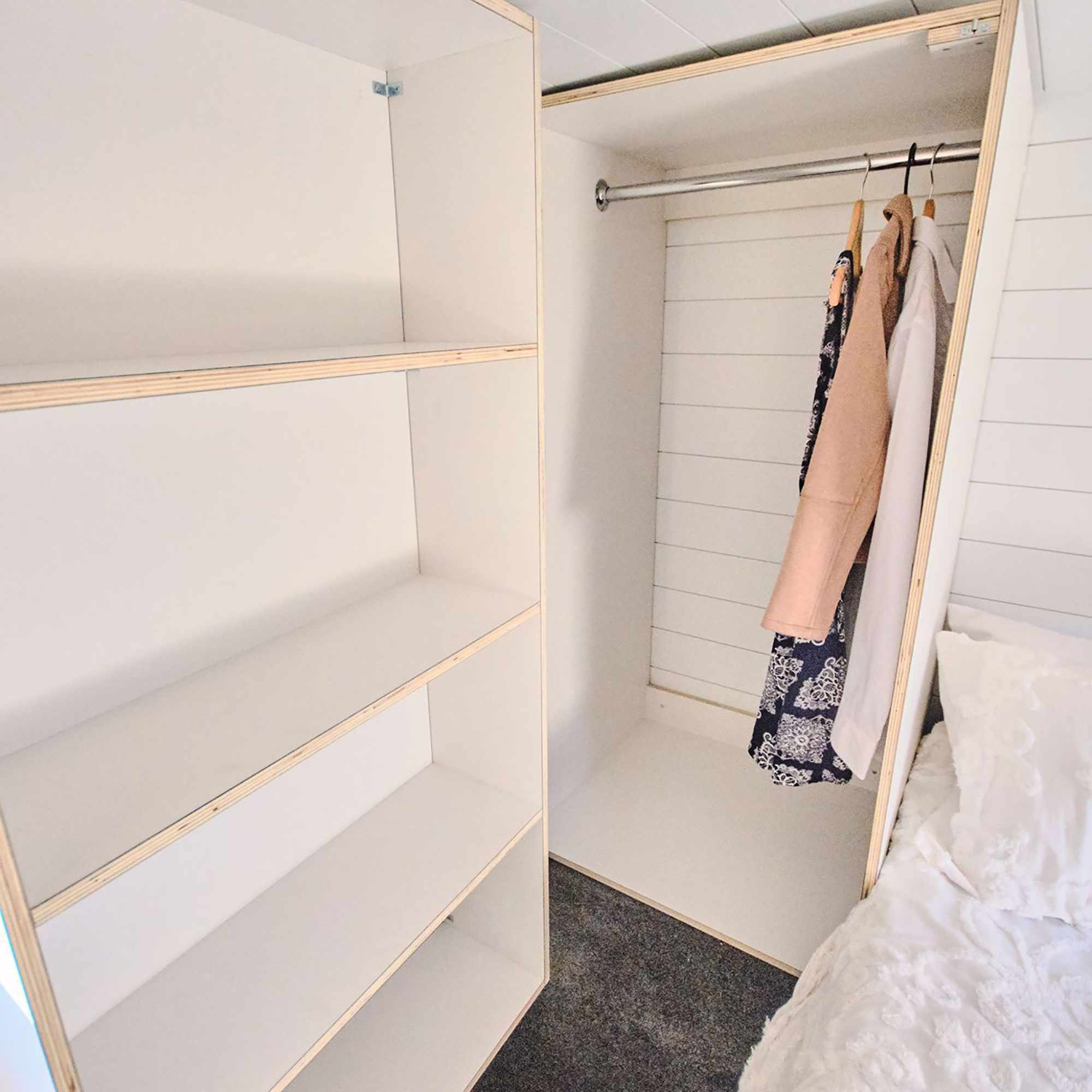 Sojourner Tiny House by Hauslein Tiny House Company closet in bedroom