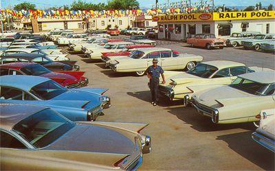 Car lot with Caddilacs