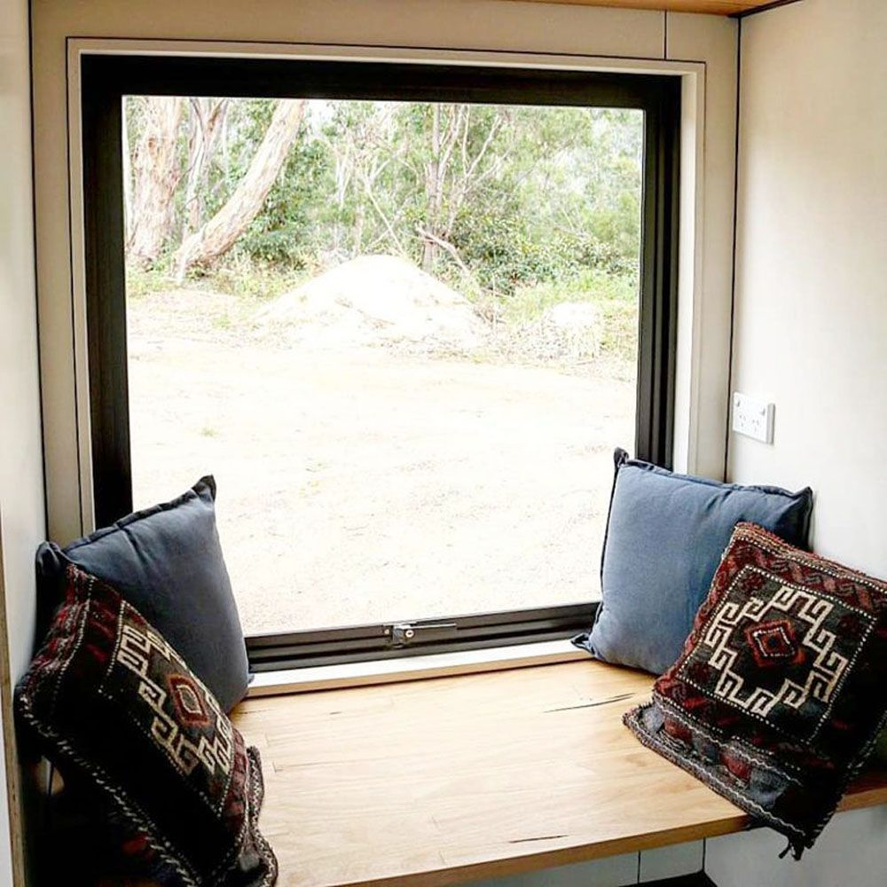 Window seat with four pillows