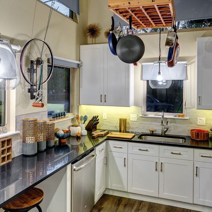 Tiny home kitchen with a hanging rack for pots and pans