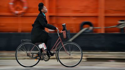 Woman riding a bike with a semcon engine attached