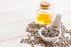 Castor oil in a glass jar with castor beans