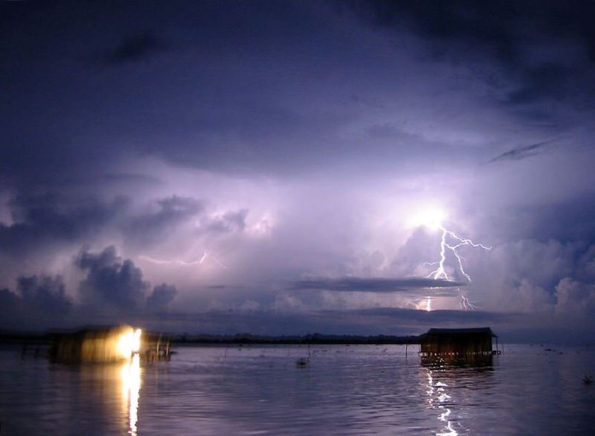 Lighting above a still body of water
