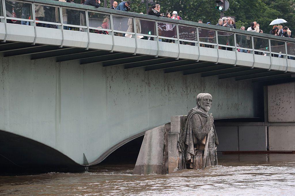 The Rivers Seine rises precariously high at Pont de l'Alma in Paris.