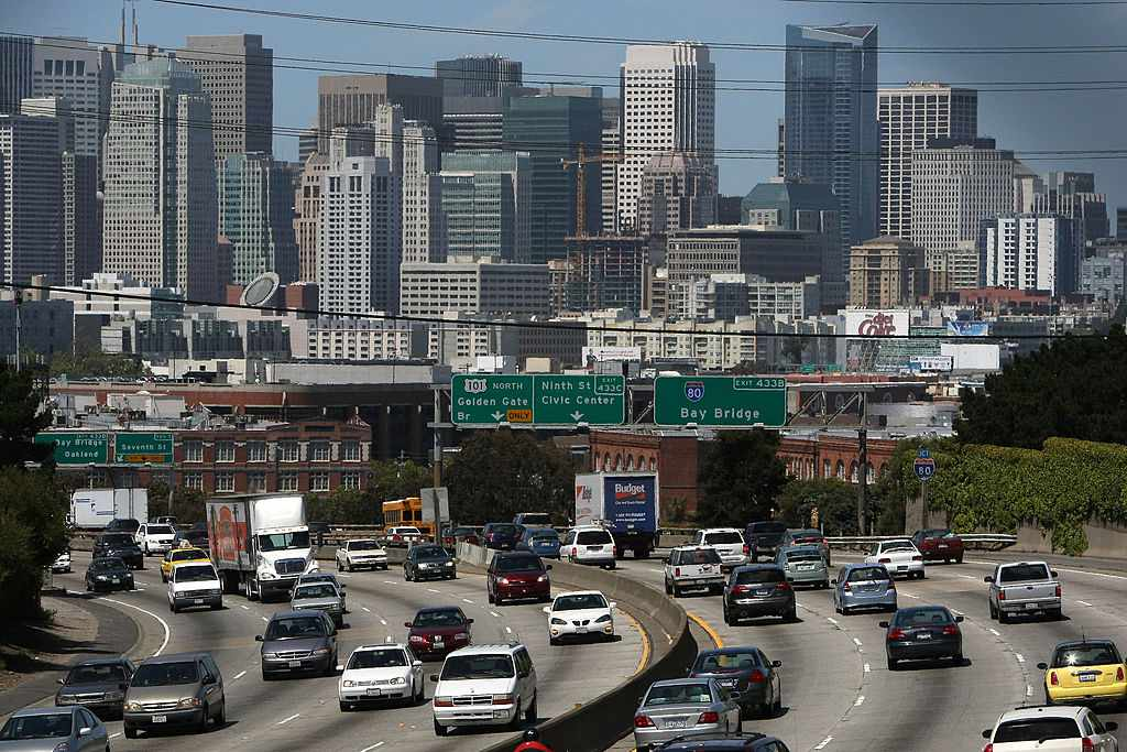 As traffic zoomed along a San Francisco highway in May 2009, President Obama announced new fuel efficiency standards for cars and small trucks.