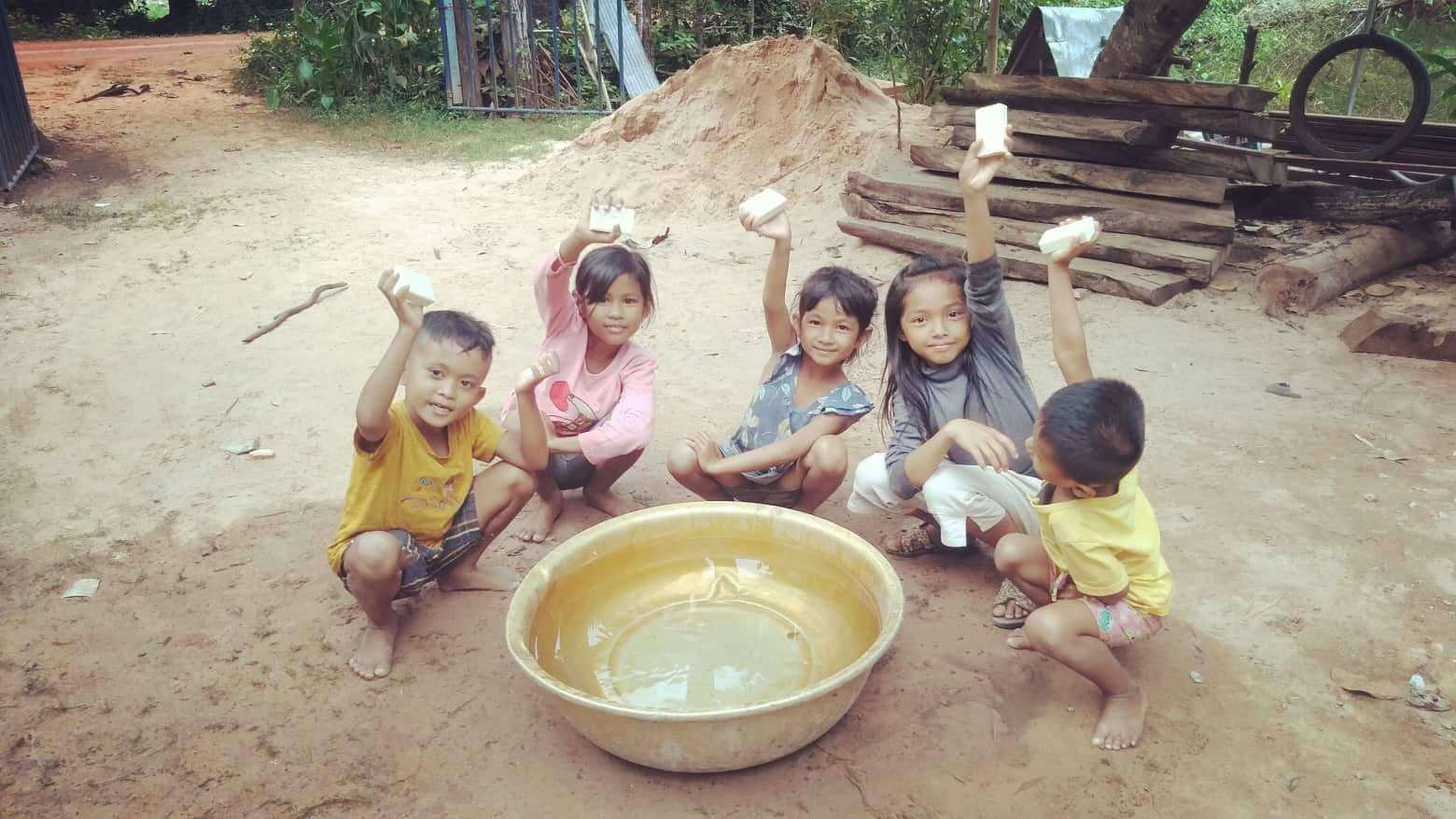 Children being given Eco-Soap bank soap in Cambodia.