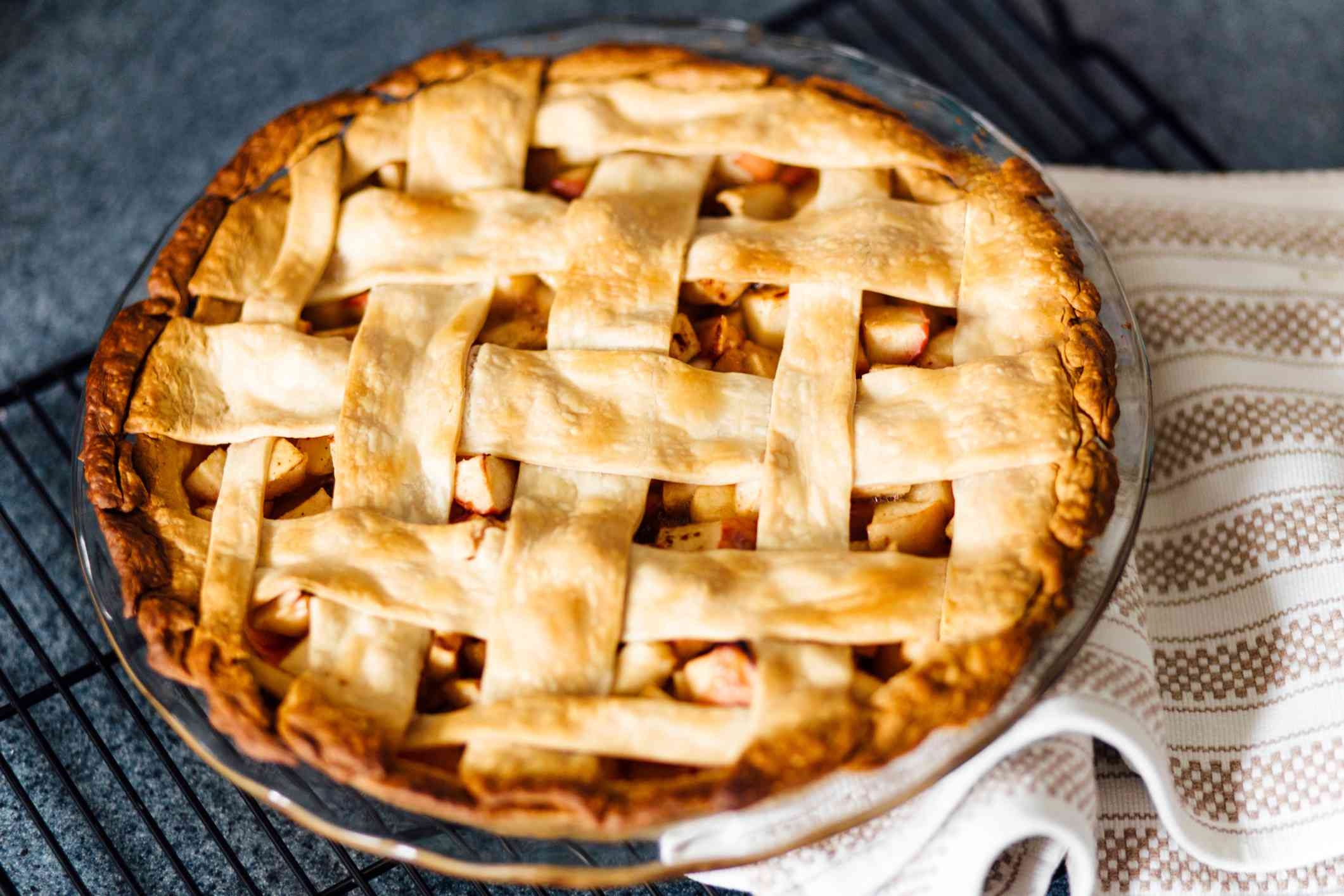 Apple pie with latticed pastry on the kitchen counter