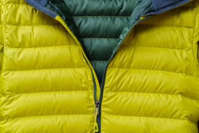 Down jacket with zipper partially pulled down