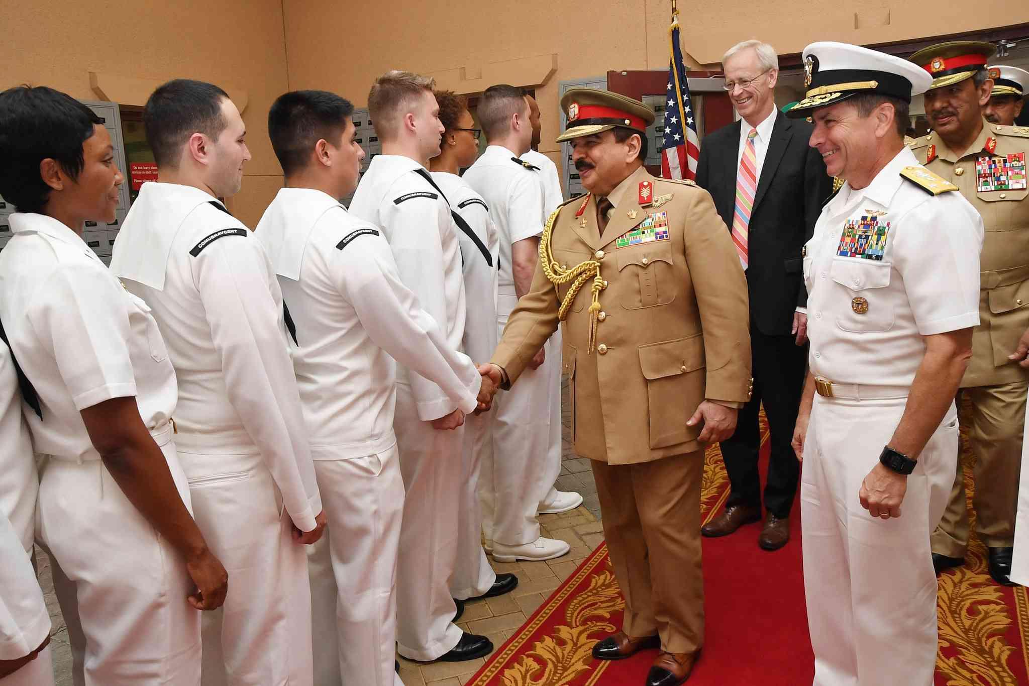 Hamad bin Isa Al Khalifa, the King of the Kingdom of Bahrain, shaking hands with Sailors.