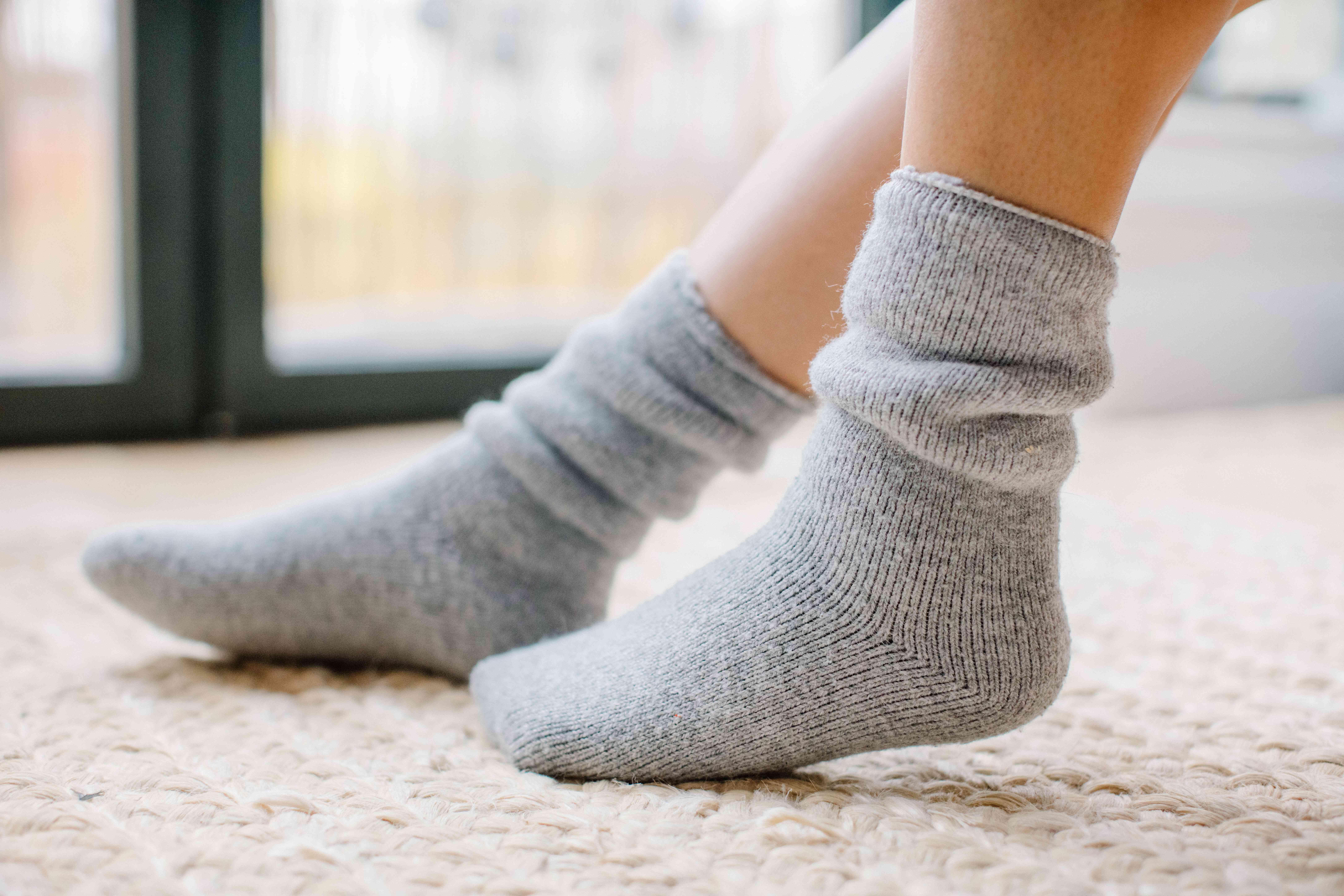 closeup thick cozy socks on feet