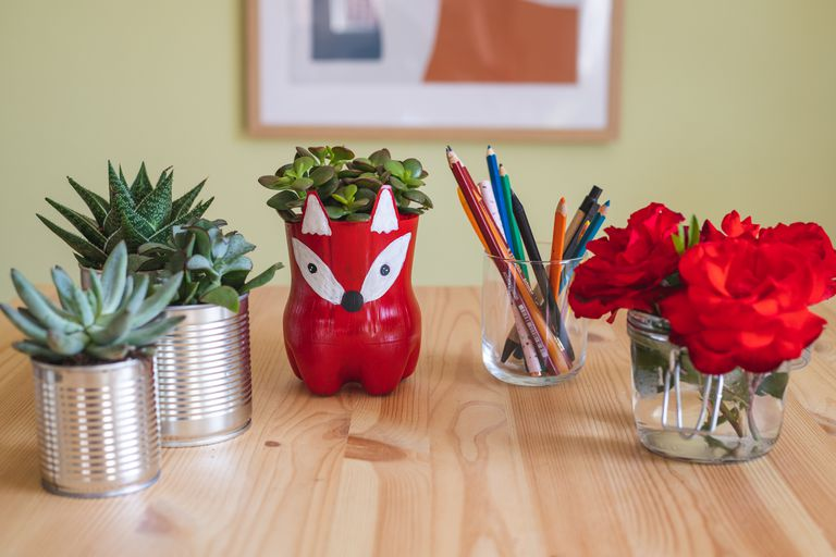 various items upcycled into new household objects including planters and vases