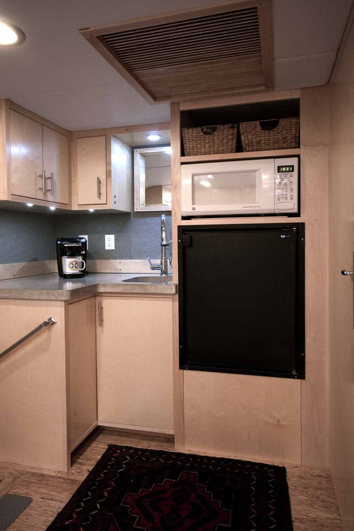 Kitchenette with counter, oven, and microwave