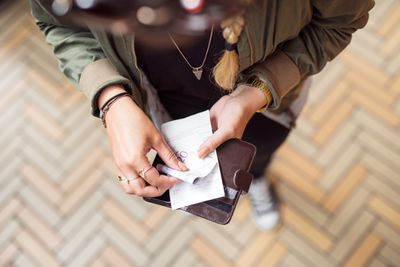 paper receipt being placed in the wallet