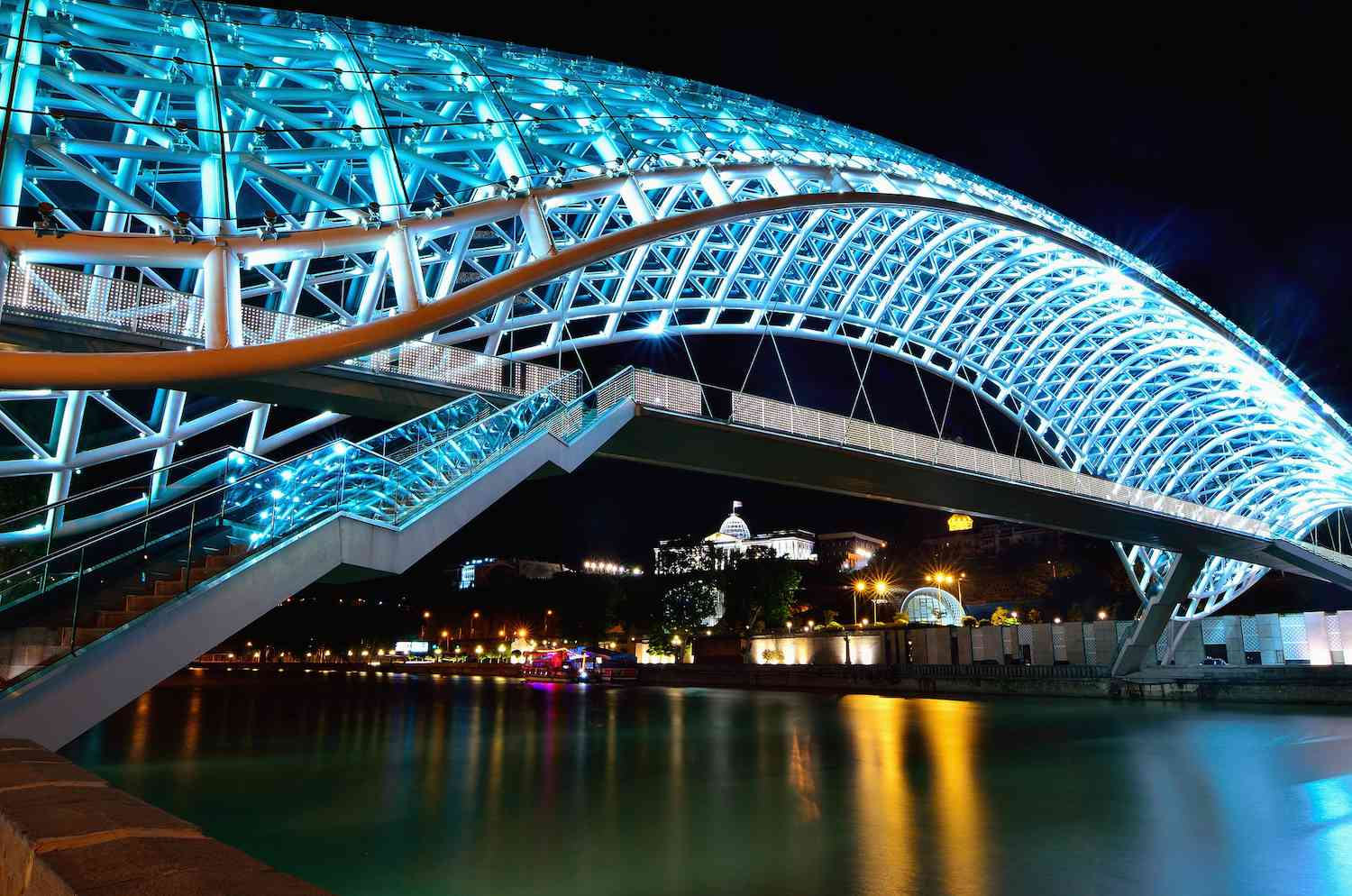 The Bridge of Peace lit up by blue LED lighting at night