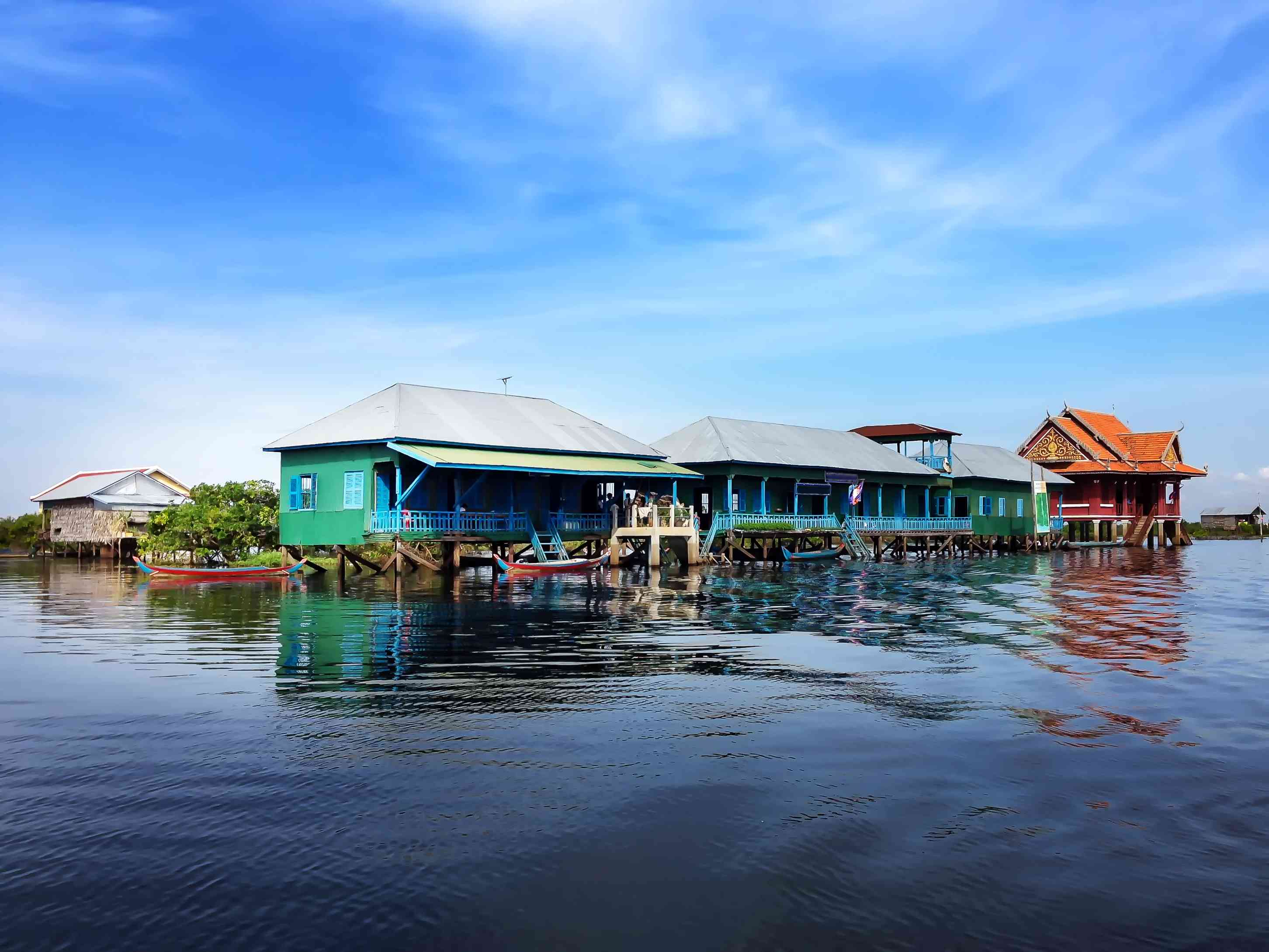 Colorful houses on stilts surrounded by lake water