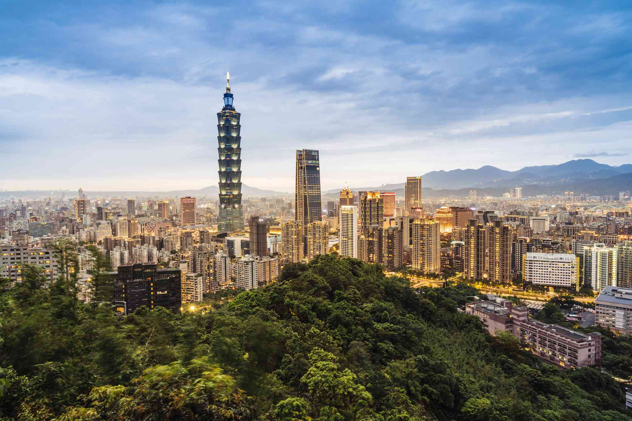 View of the city of Taipei and the tallest structure, the Taipei 101 tower, from the lush green forests of Elephant Mountain