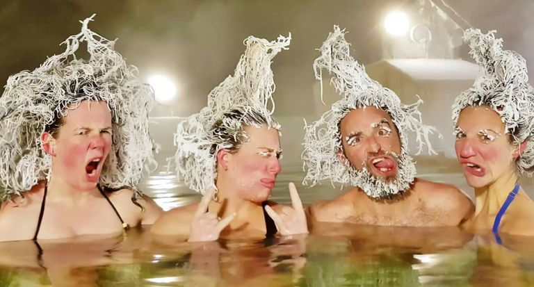 A group of people with frozen hair sittingin salt spring water.