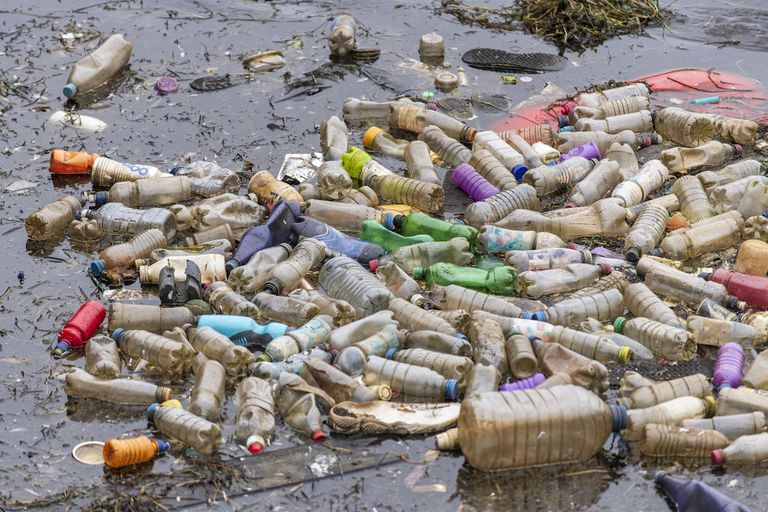 CARDIFF, UNITED KINGDOM - APRIL 09: Single use plastic bottles seen floating in polluted water near Cardiff Bay in Cardiff, United Kingdom.