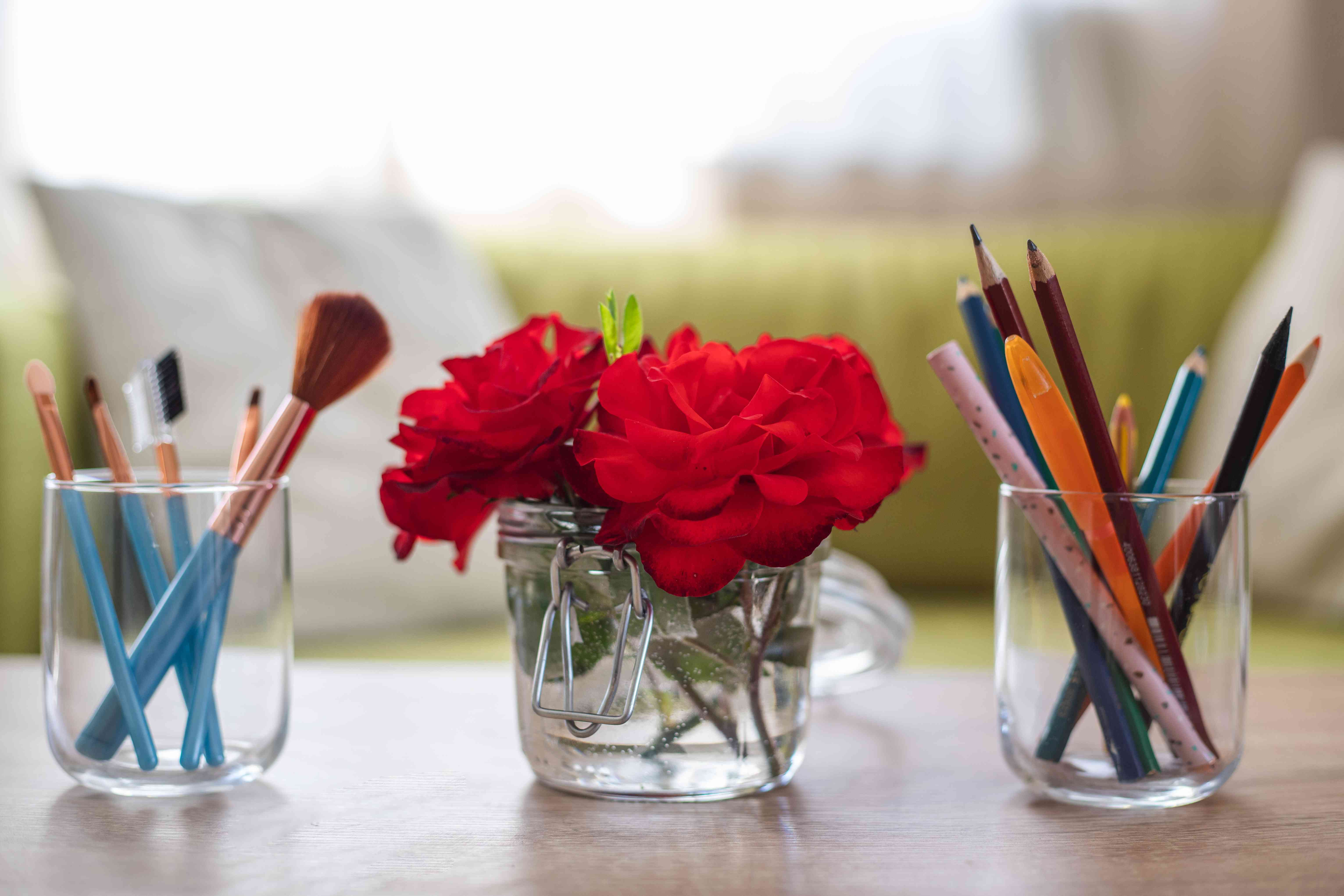 old glass containers upcycled into new vase and storage containers