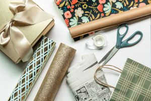 various types of wrapping paper and gift wrap materials in a flat lay