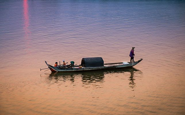 A fisherman heads home along the Mekong River in Kampong Cham, Cambodia