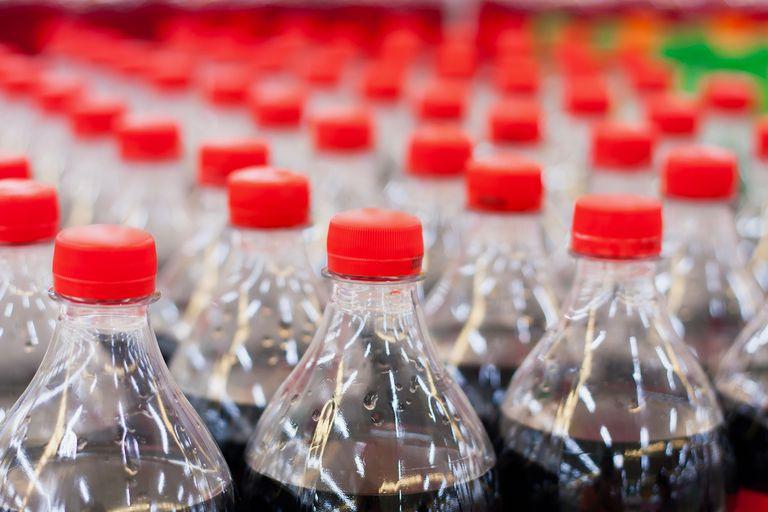 Plastic coke bottles lined up.