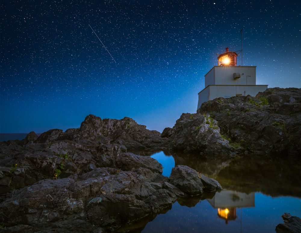 shooting star seen over Amphitrite Point Lighthouse in Ucluelet, British Columbia