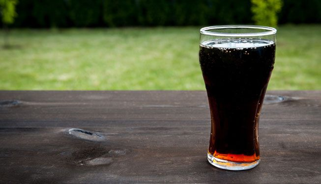 A glass of soda on a wooden table