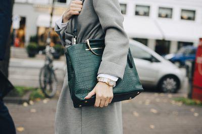 Woman wearing a green purse