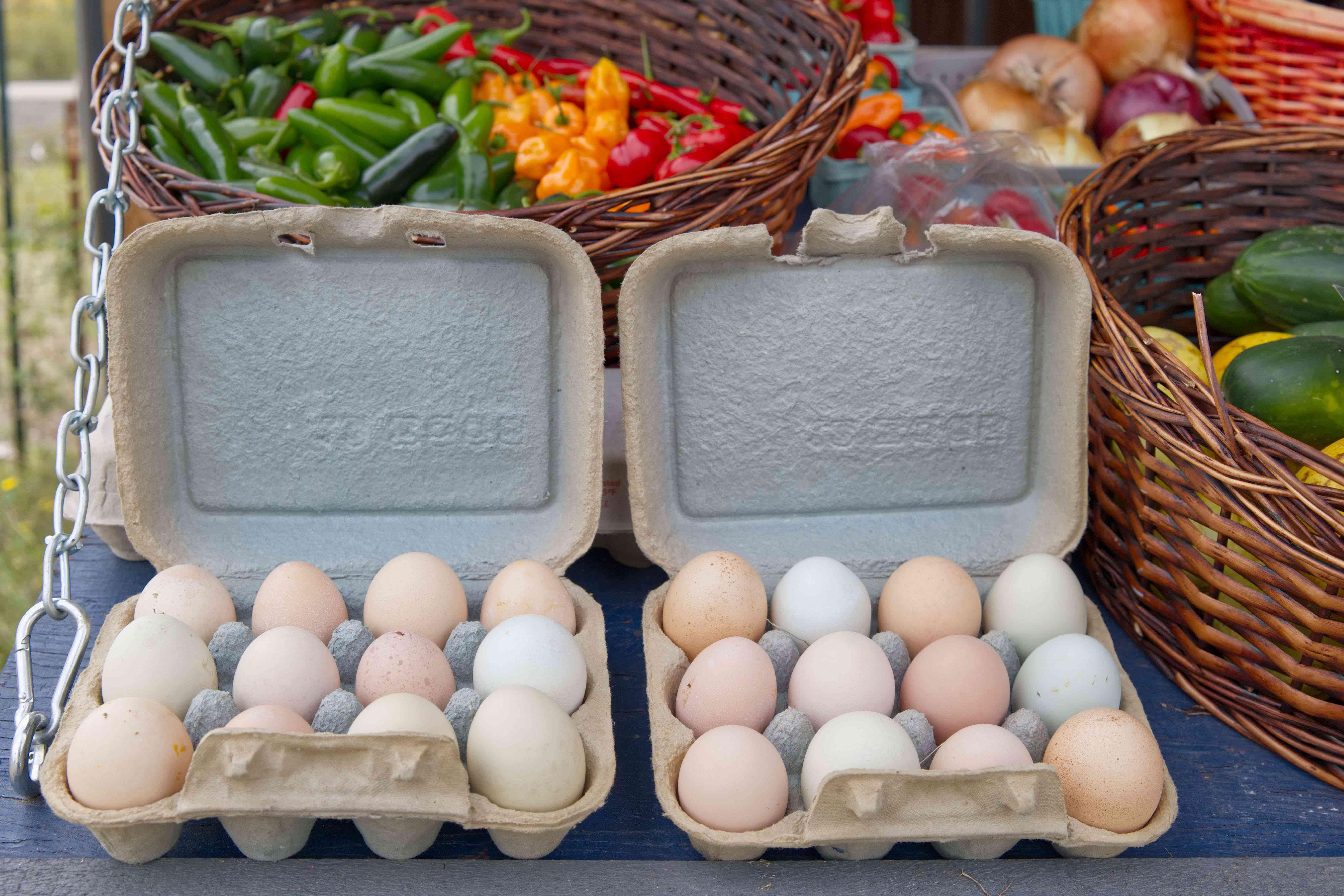 two dozen farm fresh eggs for sale at outside farmers market
