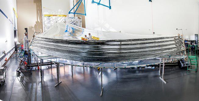 Technicians inspect the James Webb Space Telescope's sunshield