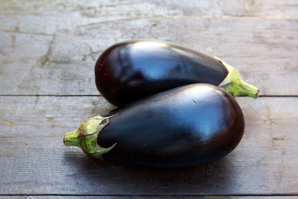 eggplants on wooden table