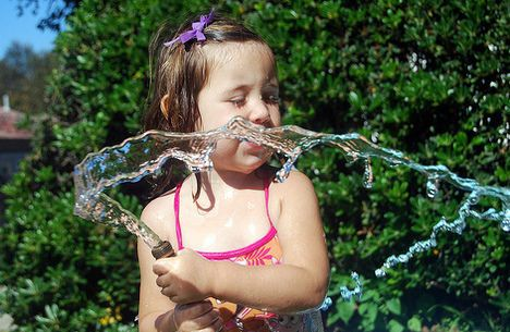 photo drinking water garden hose kid