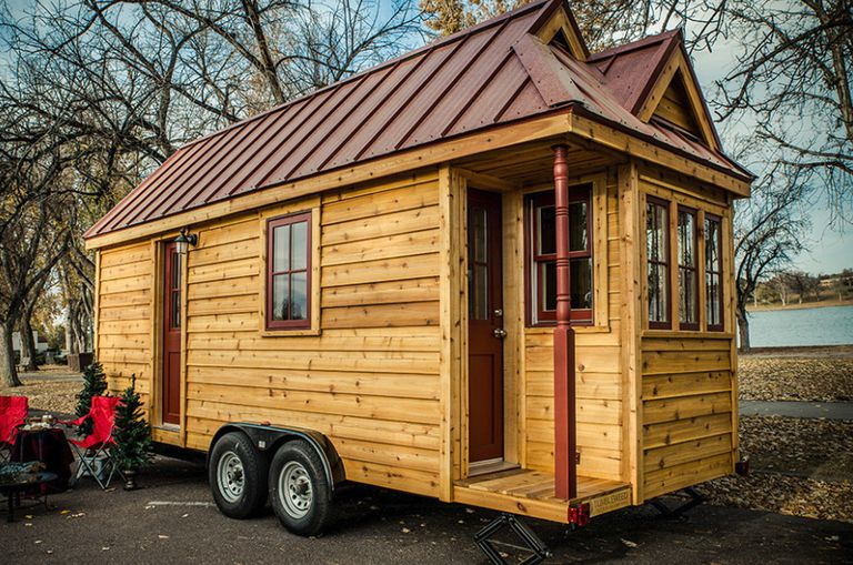 A tiny home still on its wheels and lifts