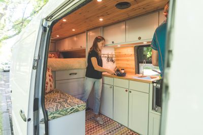Millennial couple living in a van