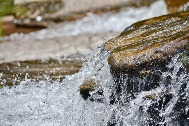 Close-Up Of Water Splashing On Rock