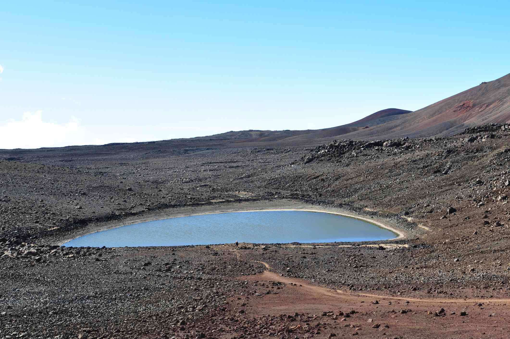 A small lake in a high, volcanic mountain environment