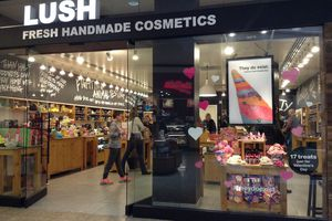 Storefront of LUSH Fresh Handmade Cosmetics with shoppers inside