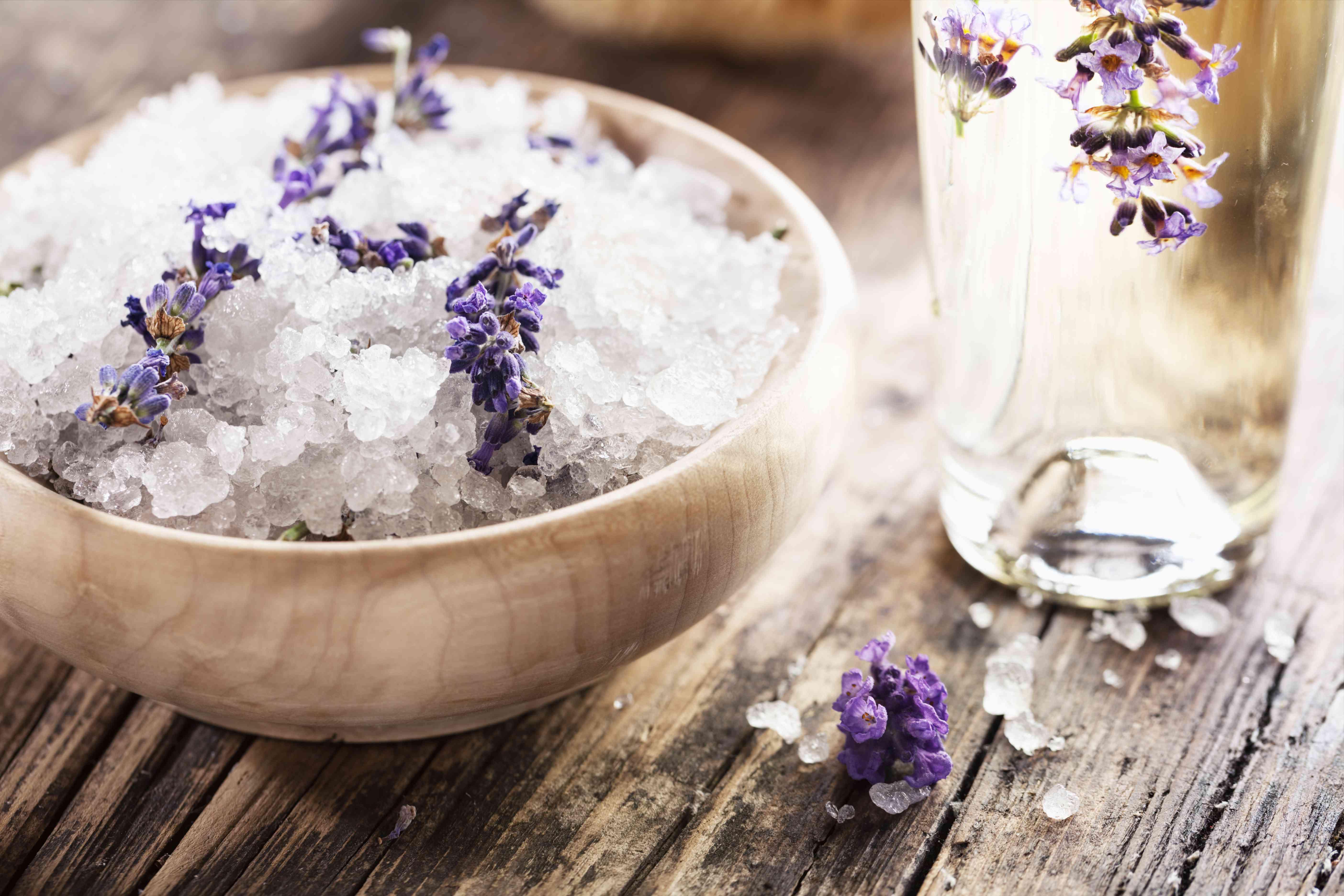 Lavender salt scrub in bowl on wooden surface