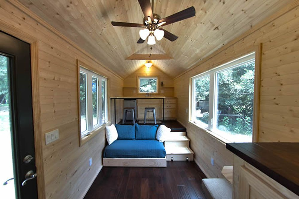 Interior of tiny home with a couch and a dining bar