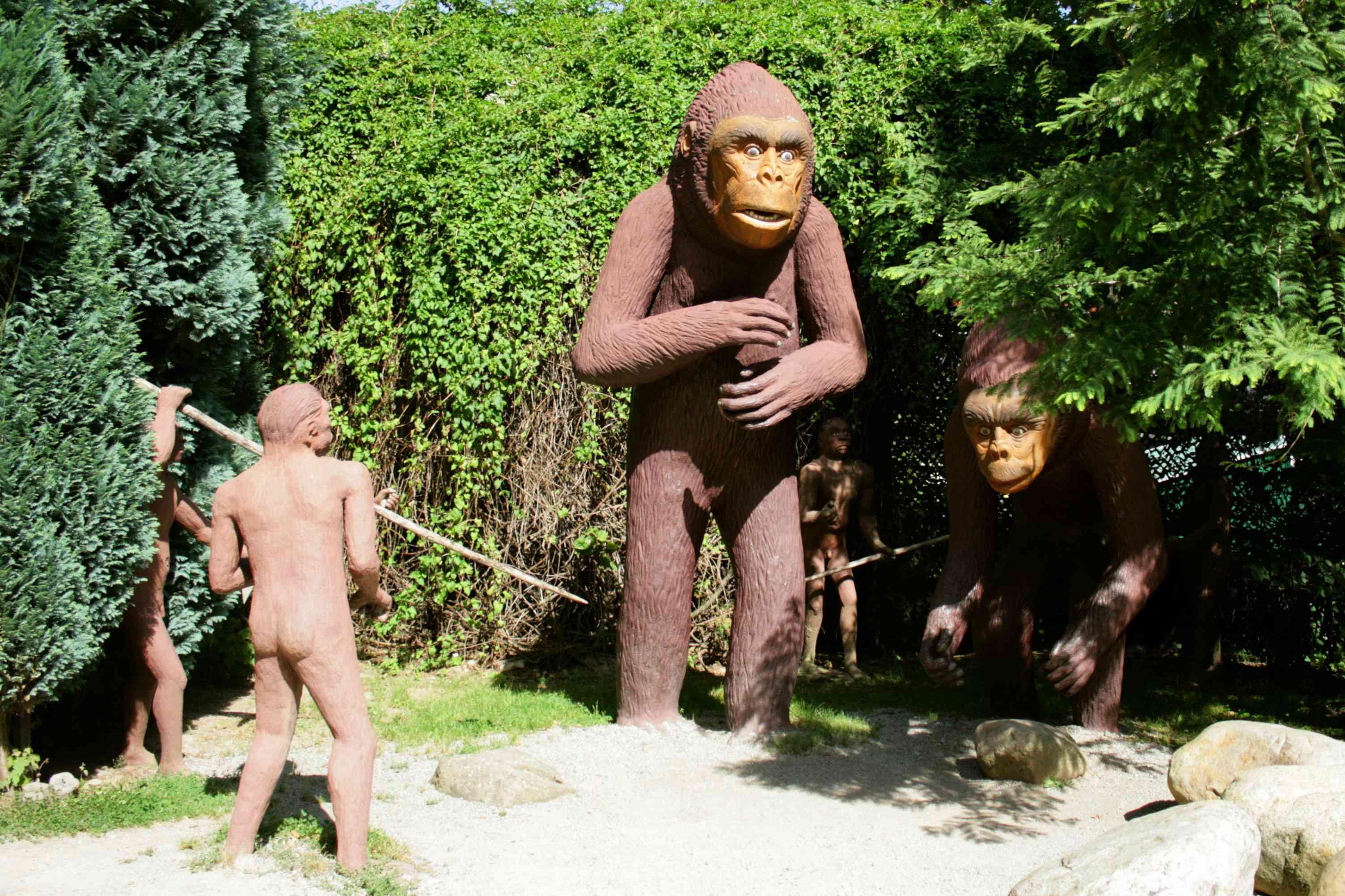 outdoor sculpture of two gigantopithecus that look like bigfoot