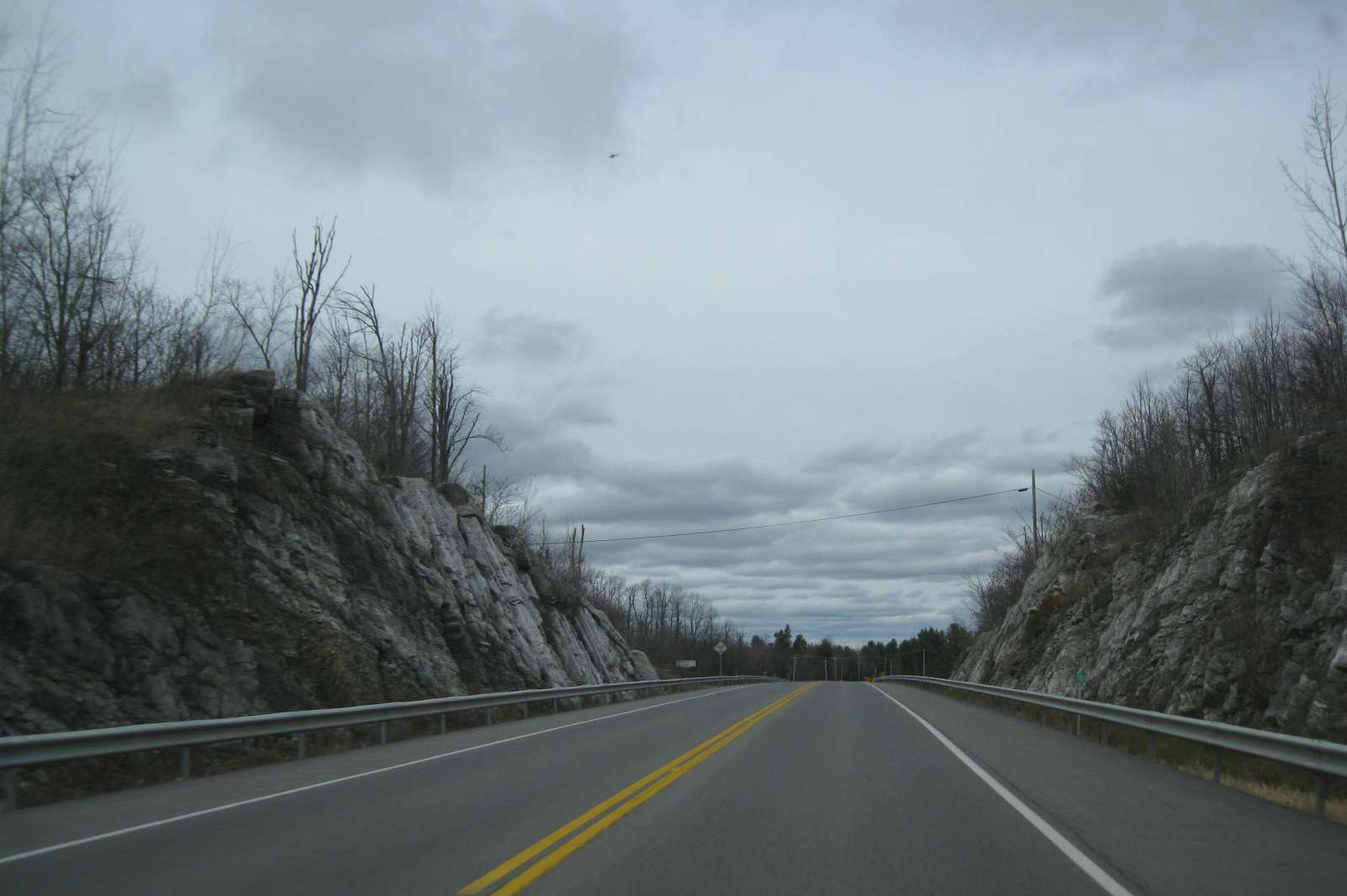 Rocks and trees along Route 812 on dreary day