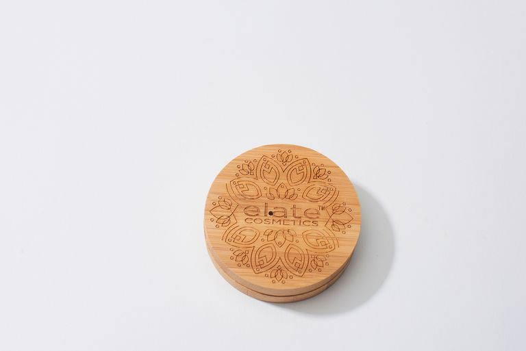 A wood carved cosmetic case.